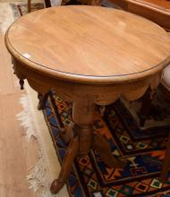 A FRENCH OAK CIRCULAR WINE TABLE