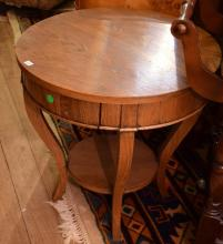 A FRENCH OAK TWO TIER CIRCULAR OCCASIONAL TABLE
