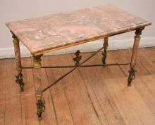 A FRENCH FIGURAL BRASS FRAMED MARBLE TOP COFFEE TABLE