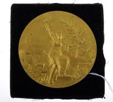 AN ANTIQUE FRENCH AND GILT BRONZE MEDALLION SIGNED P DE GREEF
