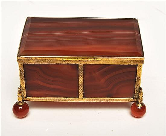 A RED AGATE AND GILT METAL BOX