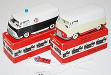 TWO TEKNO 415 TAUNUS TRANSIT MODELS INCLUDING ONE WHITE UPPER, CREAM AND RED LOWER; ONE FALCK ZONEN WHITE UPPER AND BLACK LOWER AMBULANCE (E-M BOXES G-E) (2)