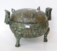 AN ARCHAIC STYLE CHINESE CENSER ON THREE FEET WITH TWIN-HANDLES