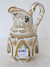A 18TH CENTURY BOHEMIAN FLASHED AND ENAMELLED DECANTER