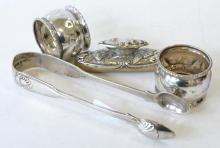 TWO STERLING SILVER NAPKIN RINGS, TONGS AND A POLISHER