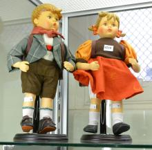 A PAIR OF LARGE GOEBEL DOLLS BOY AND GIRL WITH NAPSACKS