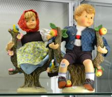 A PAIR OF LARGE GOEBEL DOLLS BOY AND GIRL ON BRANCHES