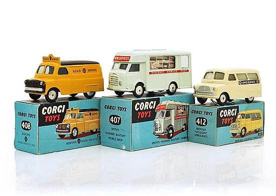 THREE CORGI COMMERCIAL VEHICLES INCLUDING 407, VERY PALE GREEN; 408; AND 412 (E-M BOXES VG) (3)
