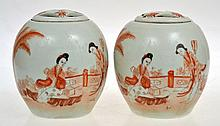 A PAIR OF CHINESE IRON RED DECORATED LIDDED POTS, 12.5 CM HIGH, FADED SEAL MARK TO ONE