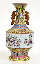 ELABORATE AND HEAVILY ENAMELLED CHINESE YELLOW GROUND FAMILLE ROSE MALLET SHAPED VASE, WITH FESTIVE SCENE, SEAL MARK TO BASE, 33 CM HIGH