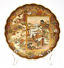 JAPANESE SATSUMA SCALLOPED BOWL WITH GILDED DECORATIVE PANELS INCLUDING GEISHAS IN GARDEN SETTING, SIGNED TO BASE, 22 CM DIA