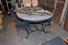 AN OVAL GREY MARBLE AND PAINTED IRON OUTDOOR TABLE