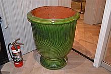 A LARGE GREEN GLAZED ANDUZE URN WITH GARLANDS