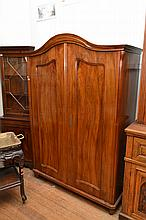 A CONTINENTAL WALNUT TWO DOOR ARMOIRE