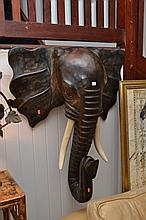 A CARVED TIMBER ELEPHANT