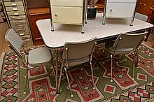 A 1950'S SEVEN PIECE DINING SETTING