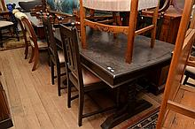 A JACOBEAN DINING SETTING COMPRISING A TABLE, FOUR CHAIRS AND TWO CARVERS