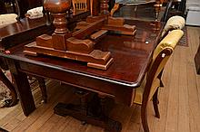 AN ANTIQUE STYLE MAHOGANY DINING TABLE
