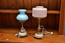 TWO BRONZE AND MARBLE TRI FOOTED TABLE LAMPS