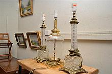 A PAIR OF CRYSTAL AND BRASS LAMPS AND ONE OTHER