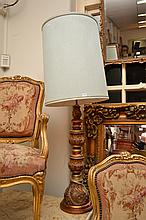A LARGE GILT TABLE LAMP WITH GREEN SHADE