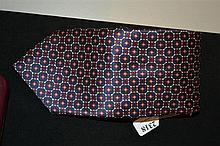 A TIE BY LOUIS FERAUD Syled in navy with abstract patterns.