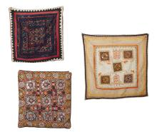 AN INDIAN GUJARAT EMBROIDERED AND MIRRORED WALL HANGING AND RAJASTHAN COVERS, 19TH/20TH CENTURY
