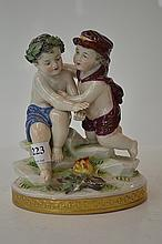 A CONTINENTAL FIGURAL GROUP OF TWO CHERUBS (SMALL REPAIR)