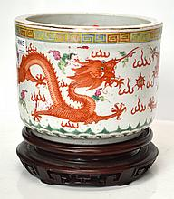 A CHINESE IRON RED DRAGON BRUSH POT ON STAND