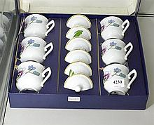 A BOXED SET OF ROYAL WORCESTER LIDDED CUPS