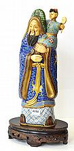A 20TH CENTURY CHINESE CLOISONNE FIGURE OF AN ELDER WITH CHILD, IVORY FACE & HANDS