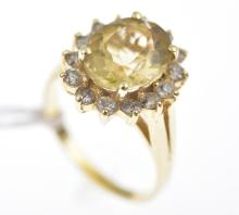 A LEMON QUARTZ AND DIAMOND CLUSTER RING IN 14CT GOLD