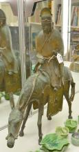 A CHINESE BRONZE FIGURE OF A SAGE ON A DONKEY