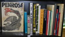 A SHELF OF ART, DESIGN AND PHOTOGRAPHY BOOKS INCLUDING 'IN AMERICA' BY EVE ARNOLD