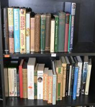 TWO SHELVES OF BOOKS CONCERNING ENGLAND AND AFRICA