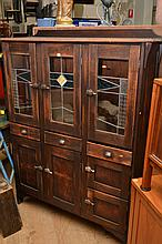 A 1920'S KITCHEN CABINET WITH LEADLIGHT DOORS