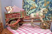 A CHARMING PAINTED AND CARVED RAJASTHANI HORSE CART