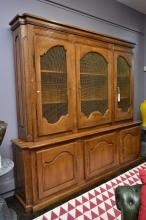A GRAND PROVINCIAL BOOKCASE WITH WIRE MESH FRONTED DOORS,