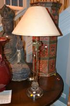 A GILT AND MOUNTED GLASS COLUMNAR LAMP BASE AND SHADE