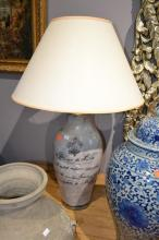 A FLEUR DE LIS DEOCRATED LAMP BASE WITH SHADE
