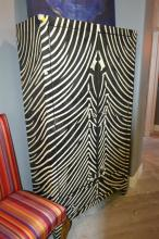 A TWO DOOR AND TWO DRAWER INLAID CUPBOARD IN A BLACK AND WHITE ZEBRA PATTERN