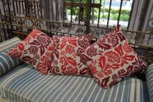 THREE DECORATIVE EMBROIDERED CUSHIONS