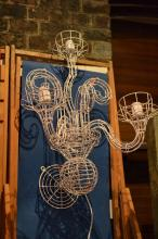 A PAIR OF FENTON AND FENTON WALL MOUNTED WIRE SCONCES