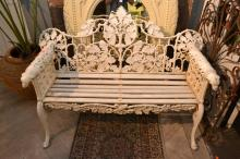 A VICTORIAN STYLE CAST IRON BENCH