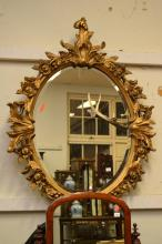 A GILT OVAL BEVELLED STYLE MIRROR