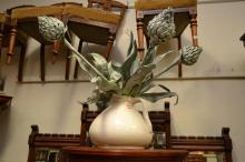 A COLLECTION OF DECORATIVE ITEMS INCLUDING A LARGE CERAMIC JUG, CERAMIC BOWL AND LIDDED CANE BASKET WITH ARTIFICIAL ARTICHOKES80
