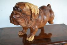A TIMBER MODEL OF A BULLDOG ALL FAULTS