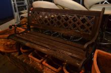 A CAST IRON OUTDOOR BENCH SEAT