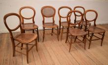 A COLLECTION OF SEVEN EARLY 20TH CENTURY RATTAN INSET BALLOON BACK CHAIRS (one in need of repair)