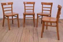 A SET OF EIGHT BEECH CAFE CHAIRS